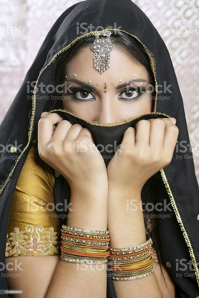 Beautiful brunette asian girl with black veil on face stock photo