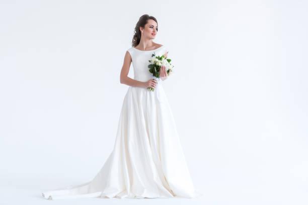 2e41b15bdc0 beautiful brunette bride posing in white dress with wedding bouquet