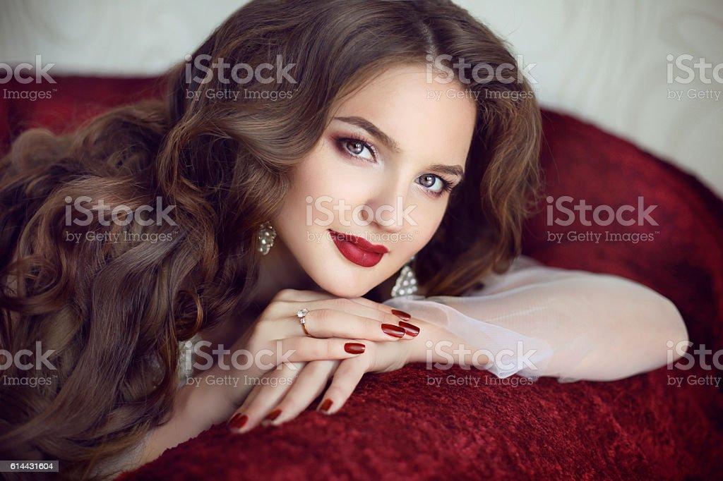 Beautiful brunette bride woman. Wedding Makeup. Red manicure stock photo