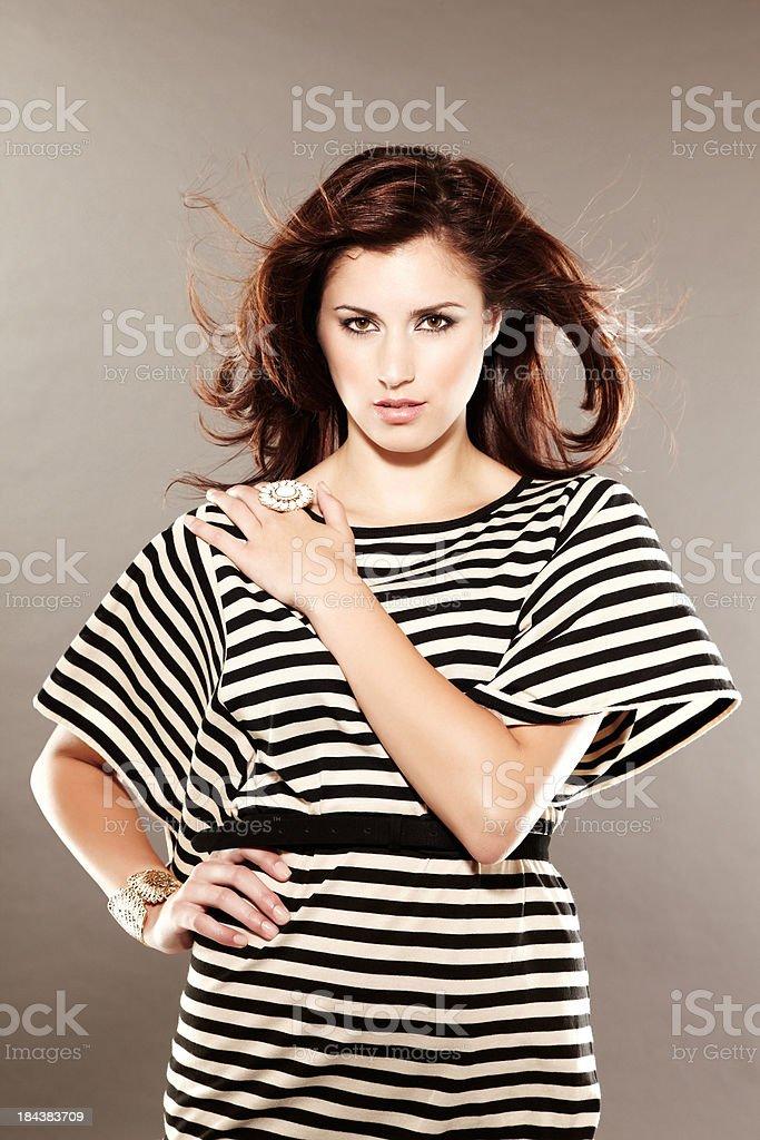 Beautiful brunette fashion model wearing striped dress royalty-free stock photo