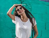 istock Beautiful brunette female model in dark sunglasses 1172756905