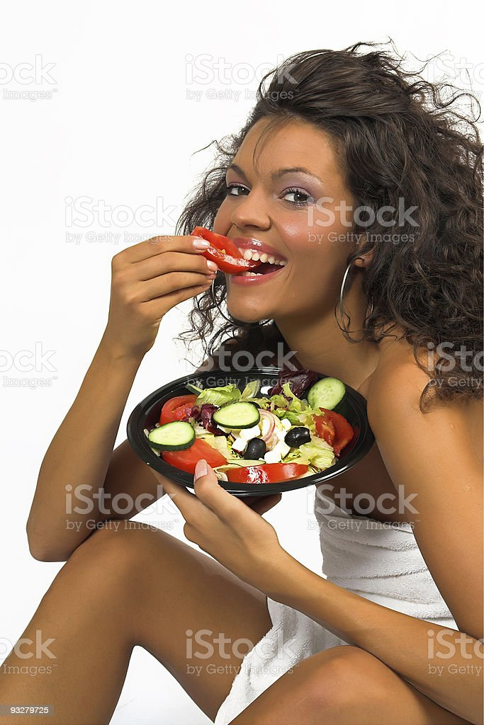 Beautiful brunette girl eating fresh salad royalty-free stock photo