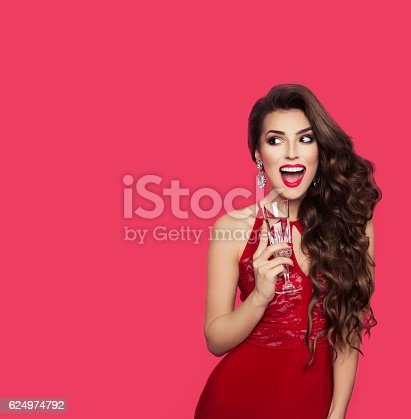 istock Beautiful brunette girl in evening dress smiling and looking left, 624974792