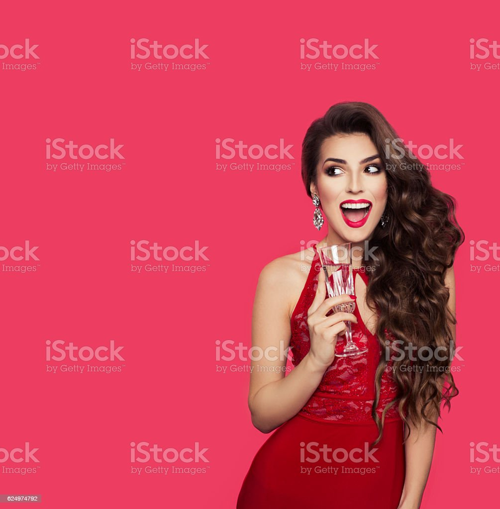Beautiful brunette girl in evening dress smiling and looking left, stock photo