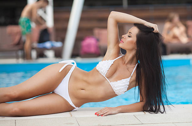 beautiful brunette girl in good shape with long dark hair - competition group stock photos and pictures