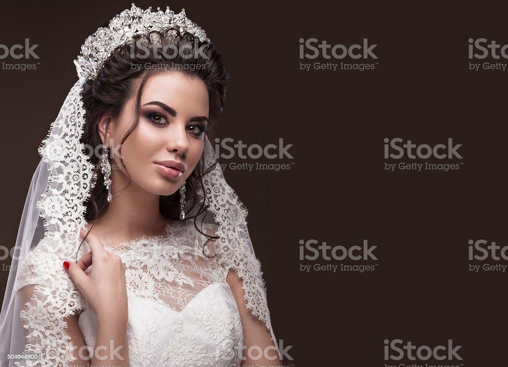 Beautiful brunette girl in image of Arab bride, wedding dress stock photo