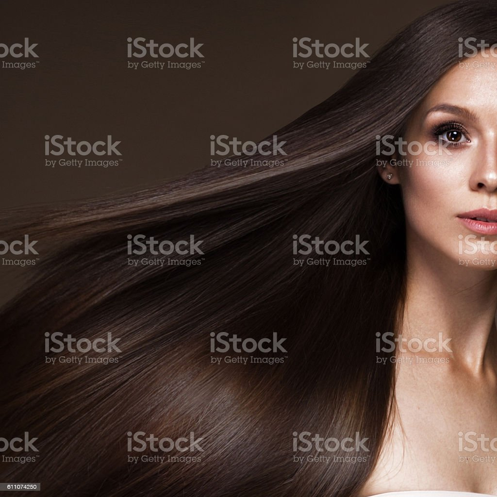 Beautiful brunette girl in move with a perfectly smooth hair stock photo