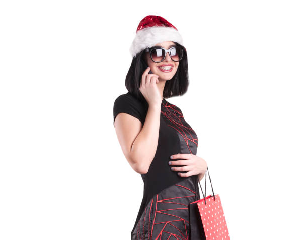 Beautiful Brunette Girl In Santa Hat Wearing Black Glasses
