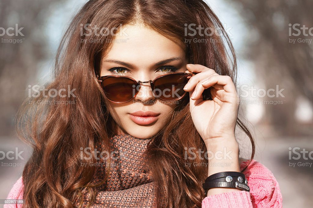 Beautiful brunette girl on the street stock photo