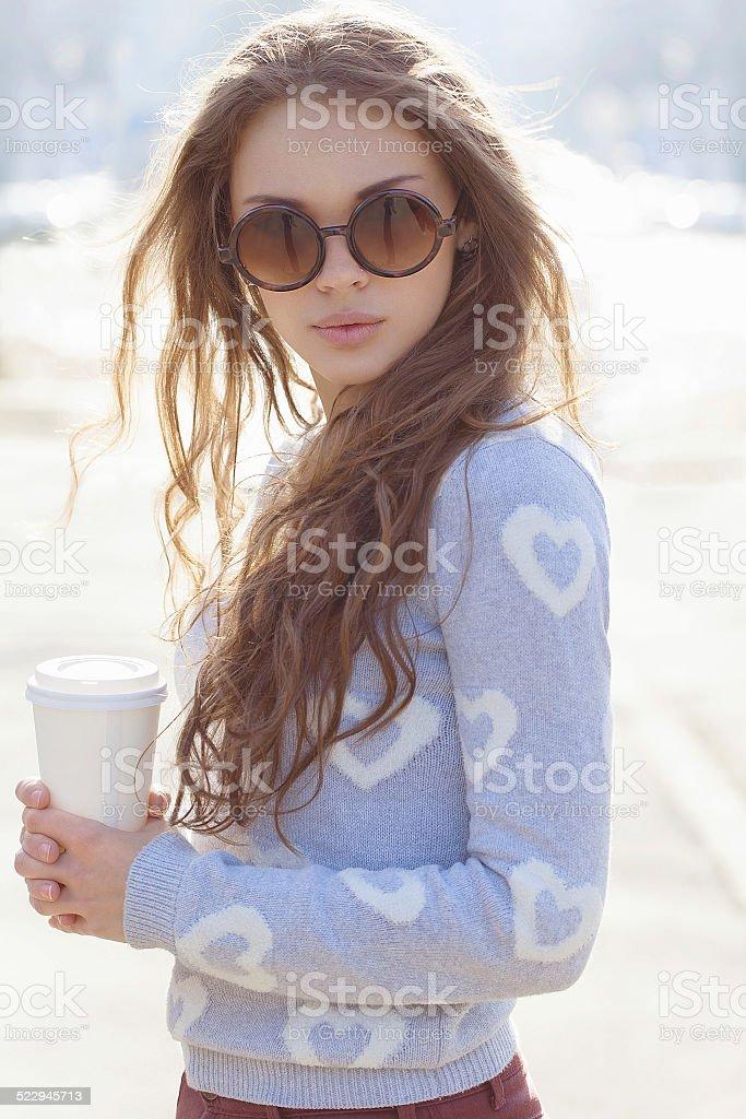 Beautiful brunette girl walking stock photo