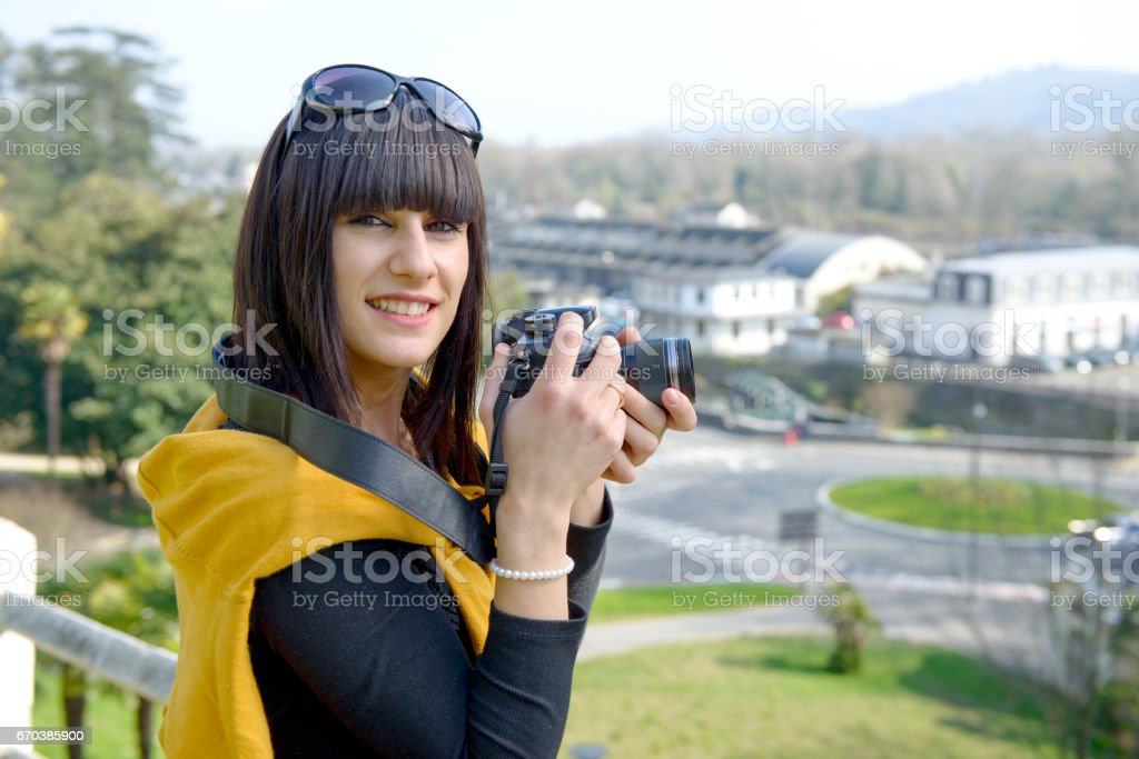 Beautiful Brunette Girl With Camera Visiting French City Pau Royalty Free Stock Photo
