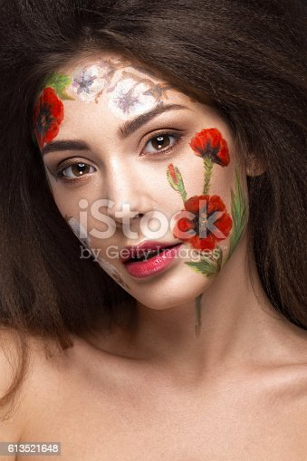 istock Beautiful brunette girl with curls and a floral pattern on 613521648