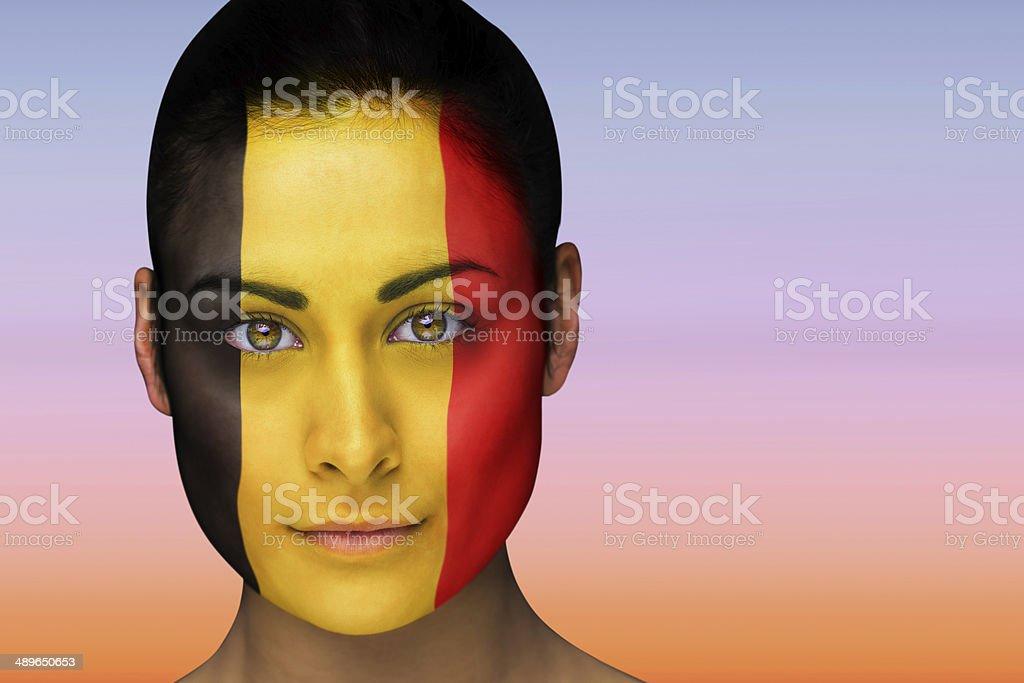 Beautiful brunette in belgium facepaint stock photo