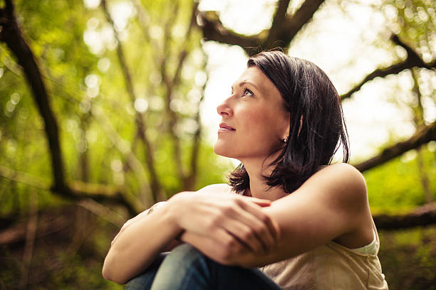 beautiful brunette in nature - 30 39 years stock photos and pictures