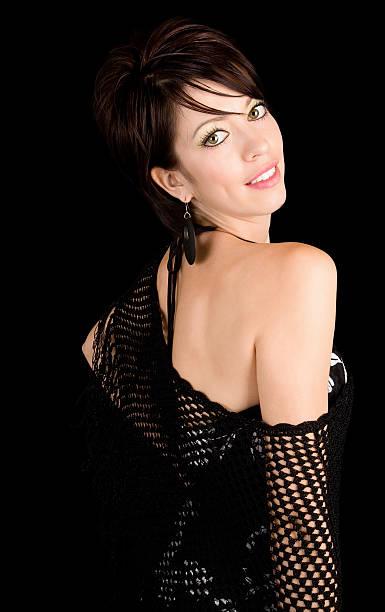 Beautiful Brunette Lady Posing in a Black Dress stock photo