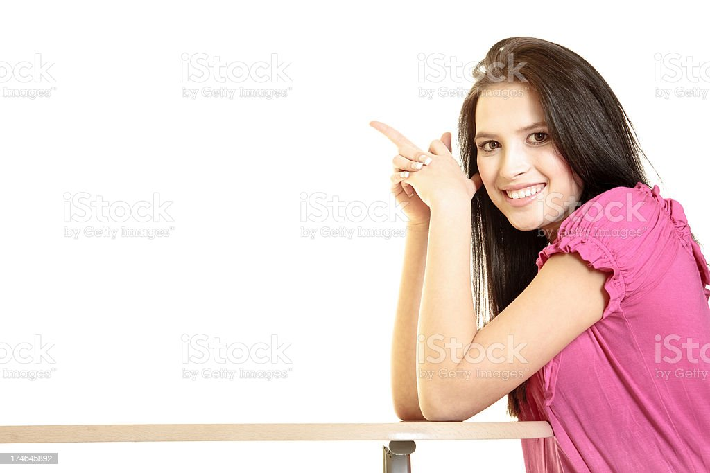 Beautiful brunette leaning against the table stock photo