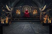 istock Beautiful brunette majestic woman in luxuious dress sitting on throne 1145722750