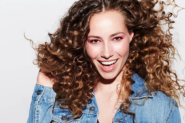 Beautiful brunette model smiling at camera stock photo