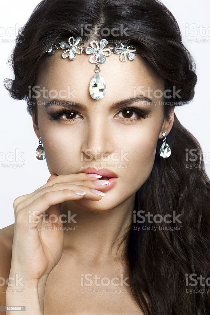 Beautiful brunette model with long curly brown hair. royalty-free stock photo