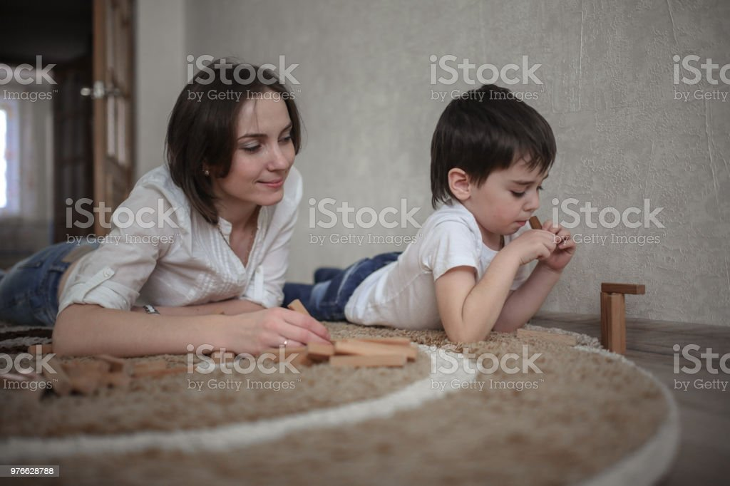 Beautiful Brunette Mom Playing With Kid Boy Royalty Free Stock Photo