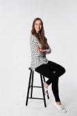 Beautiful brunette on stool, portrait