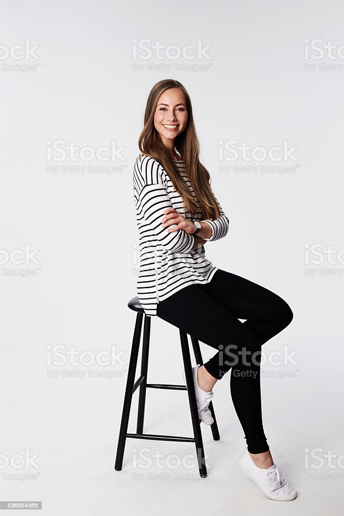 Beautiful brunette on stool, portrait stock photo