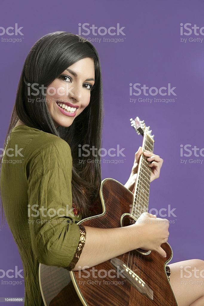 Beautiful brunette playing acoustic guitar royalty-free stock photo