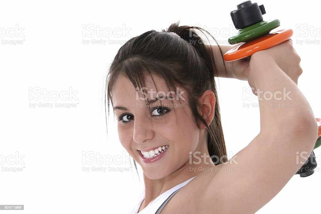 Beautiful Brunette Teen with Hand Weights royalty-free stock photo