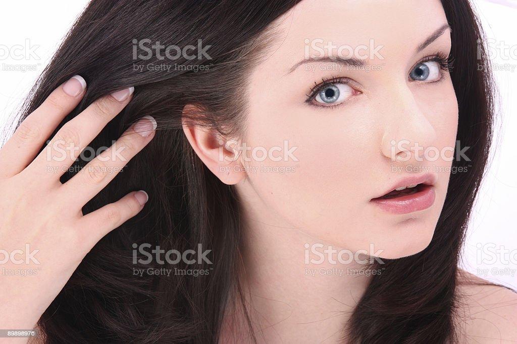 Beautiful brunette touching hair on white royalty-free stock photo