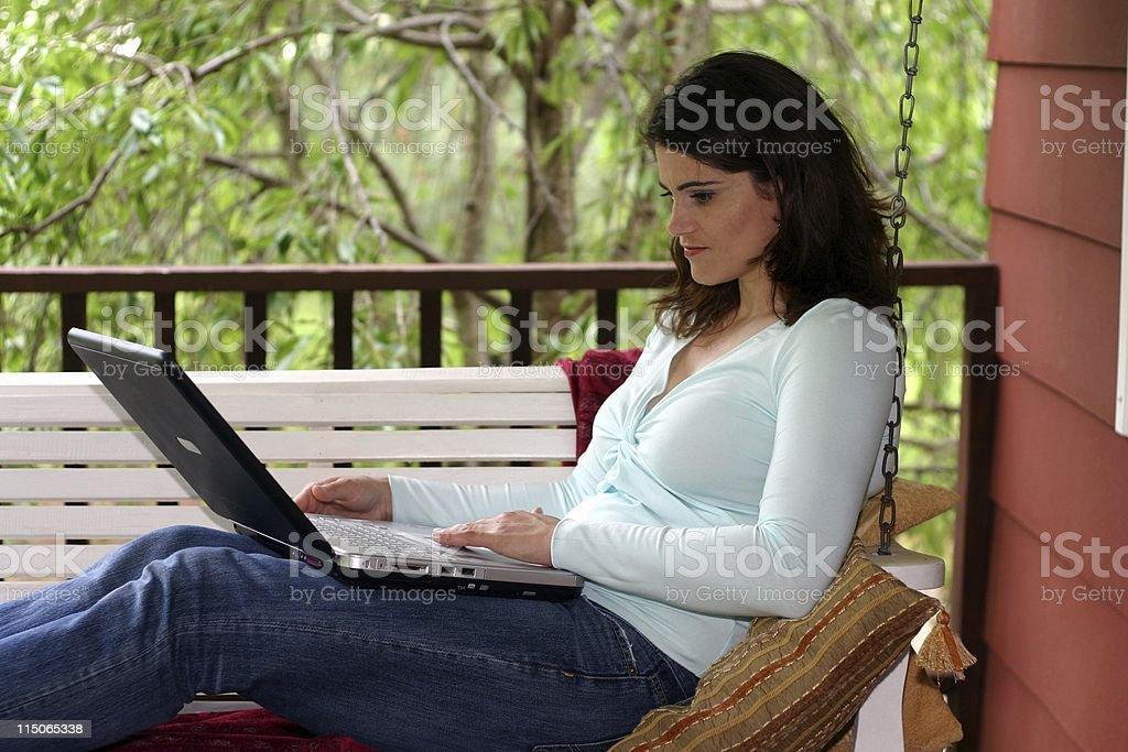 Beautiful Brunette using Laptop royalty-free stock photo