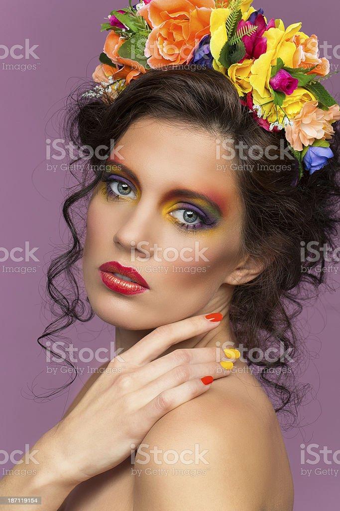 Beautiful brunette wearing flower headband royalty-free stock photo