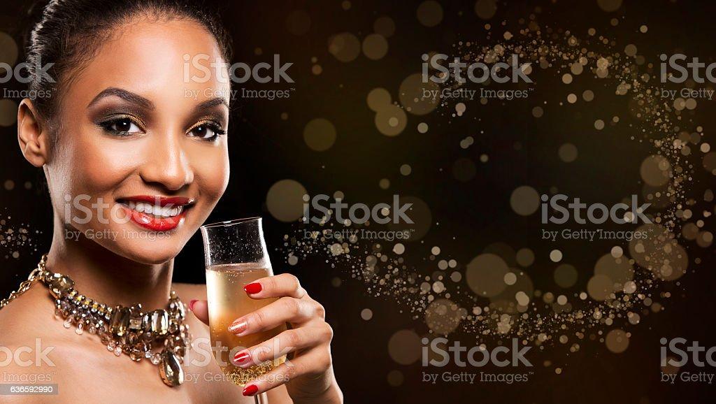 beautiful brunette with dark makeup wearing gold jewellery stock photo