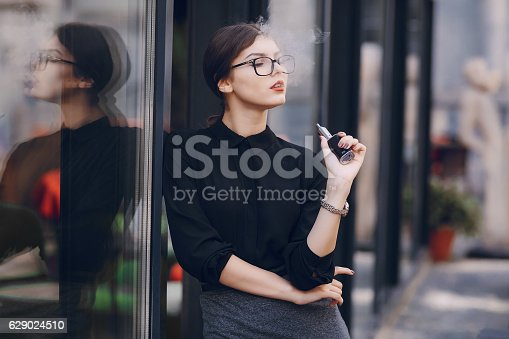 istock beautiful brunette with glasses 629024510