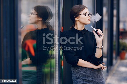 istock beautiful brunette with glasses 636009252