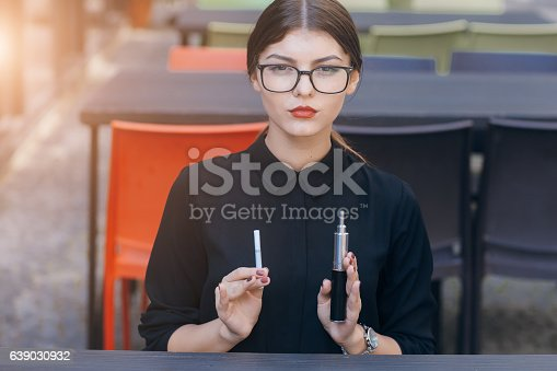 istock beautiful brunette with glasses 639030932