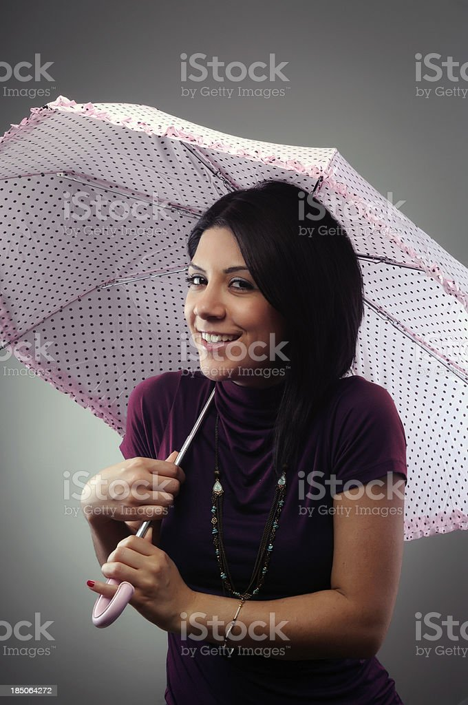 Beautiful Brunette with pink umbrella royalty-free stock photo