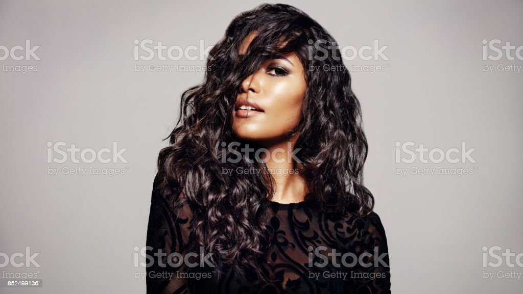 Beautiful brunette with wavy hairstyle stock photo