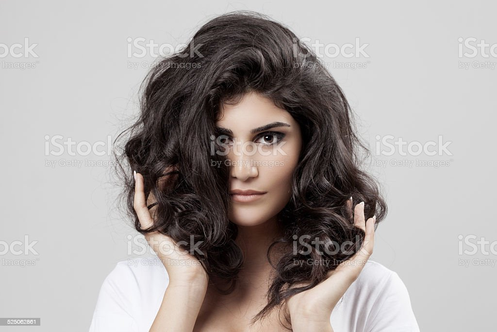 Beautiful Brunette Woman. Curly Long Hair. stock photo