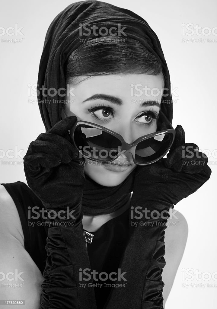 beautiful brunette woman in a retro style stock photo