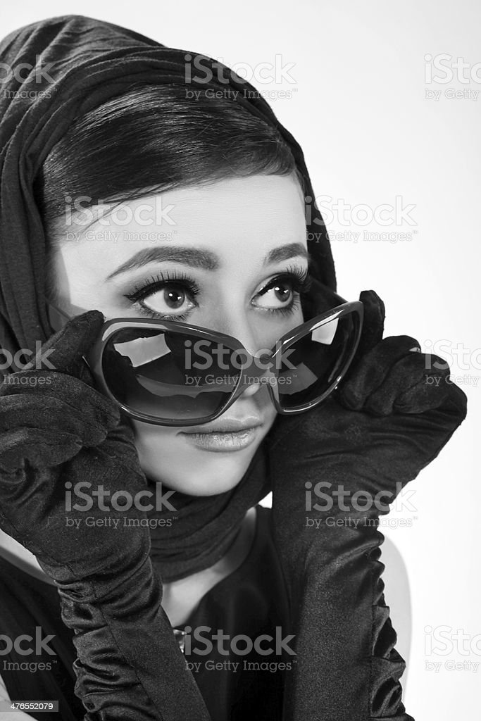beautiful brunette woman in a retro style with sunglasses stock photo