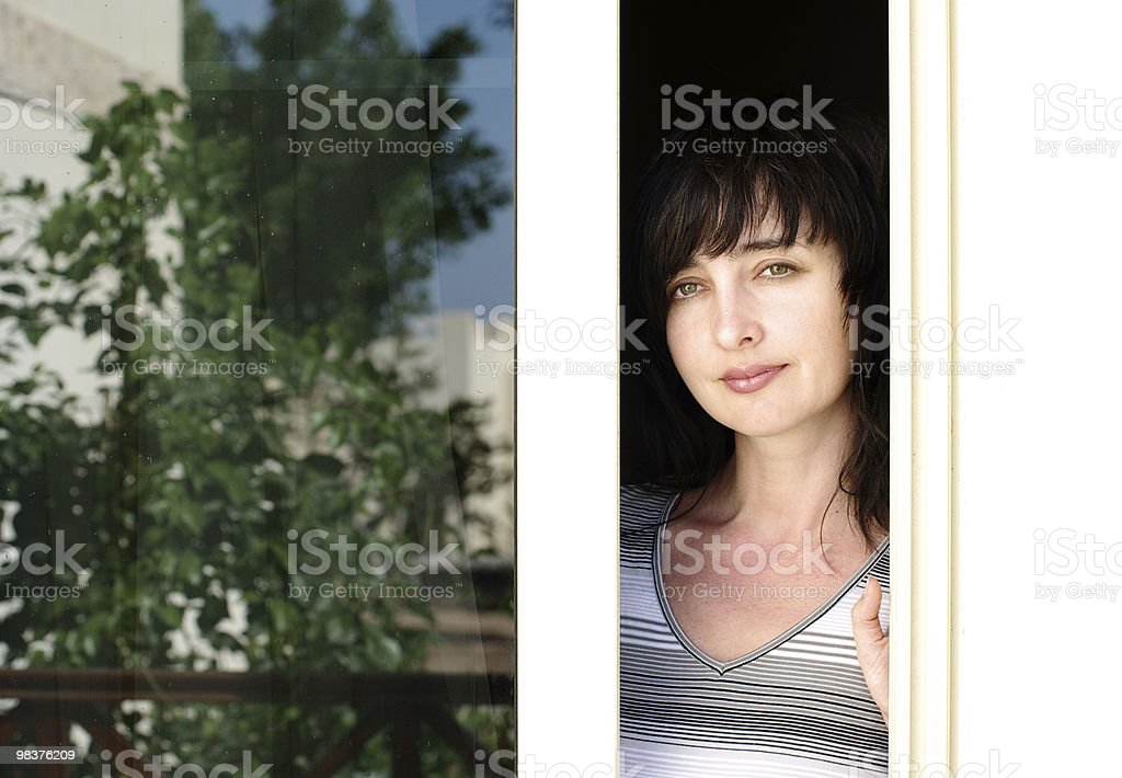 Beautiful brunette woman looking from the balkony royalty-free stock photo