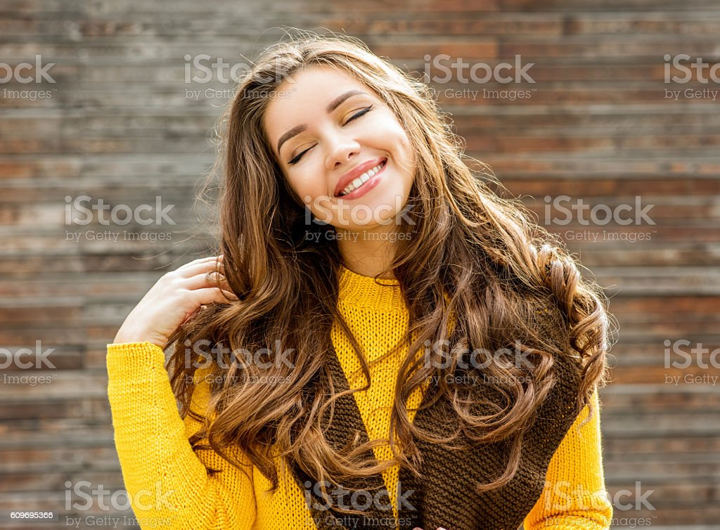 Beautiful brunette woman  over wooden background. stock photo