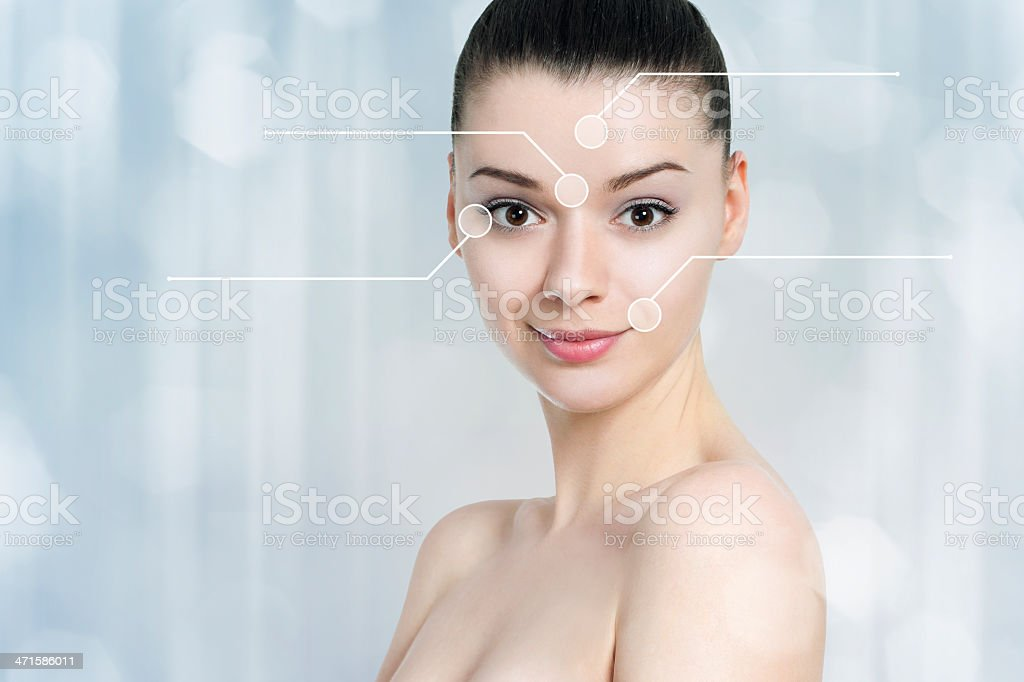 Beautiful brunette woman pointed wrinkles spots. stock photo