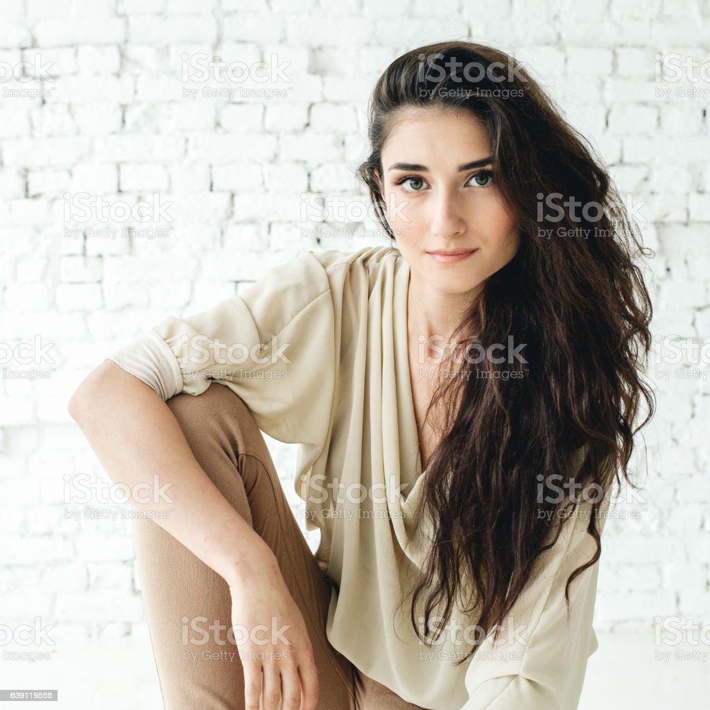 Beautiful brunette woman portrait. Natural makeup. Studio shot. stock photo