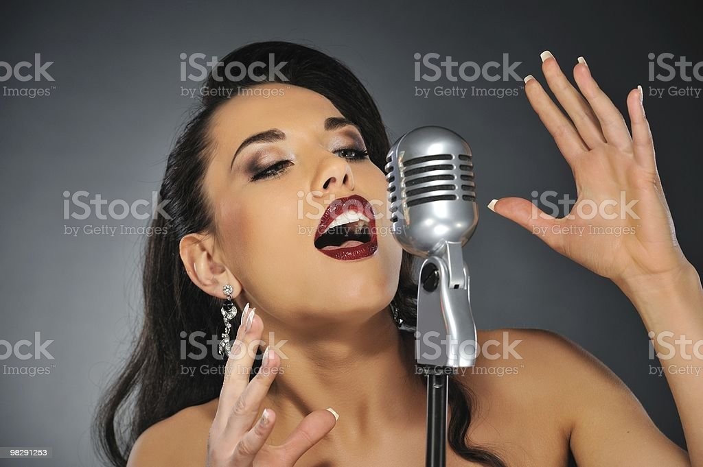 Beautiful brunette woman singing royalty-free stock photo