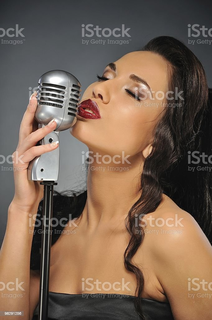 Beautiful brunette woman singing royalty-free stock photo
