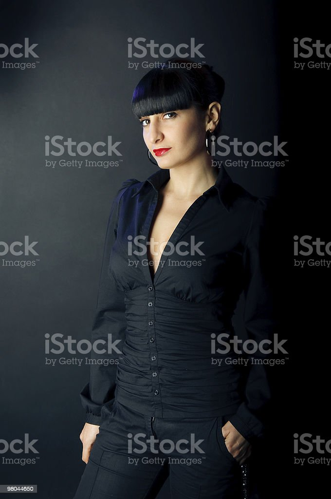 beautiful brunette woman stand on black background royalty-free stock photo
