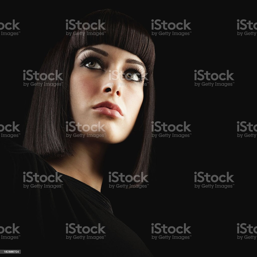 Beautiful Brunette Woman with Blunt Hairstyle on Black Background stock photo