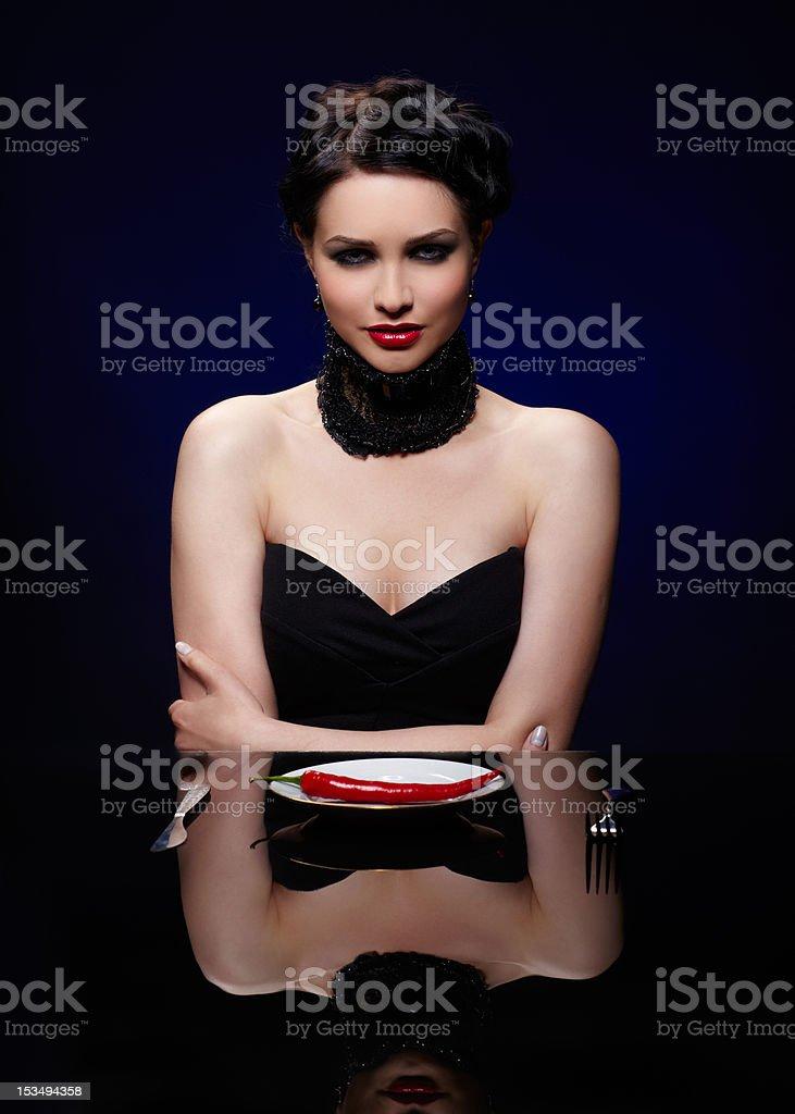 beautiful brunette woman with cayenne royalty-free stock photo