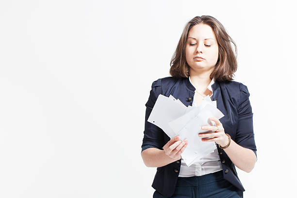 Beautiful brunette young business woman with papers stock photo